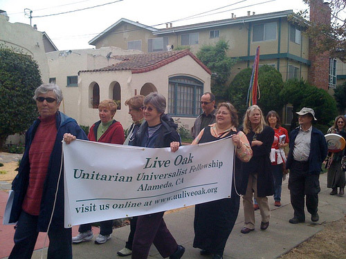 Live Oak members carrying banner at Coming Out Day celebration