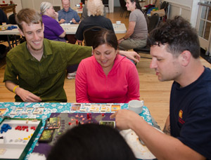 Eric, Reena, and Mugsy playing Pandemic
