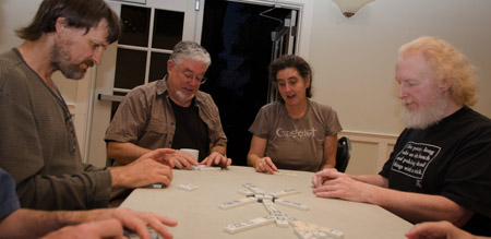 Adults playing Chicken-feet Dominos.