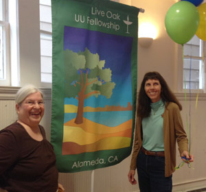 Two members displaying the new Live Oak banner.