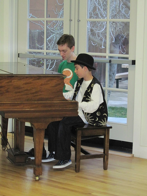 Two boys playing the piano