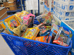 Shopping cart filled with toys for tots campaign.